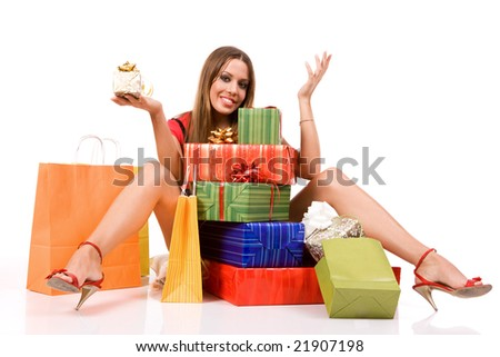 Shopping woman with colorful bags and gift boxes. - stock photo