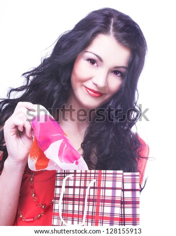 Shopping. Young happy woman with bright bags. - stock photo