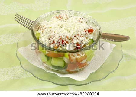 Shopska mixed salad in glass plate - stock photo