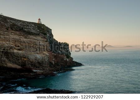 Shore and lighthouse at Dunedin, South Island, New Zealand - stock photo