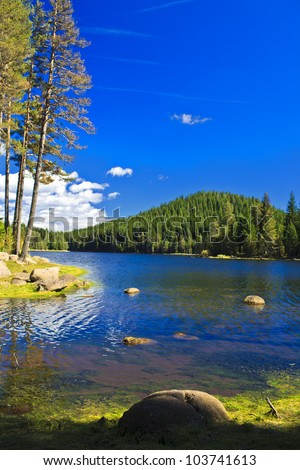shore view to mountain lake - stock photo
