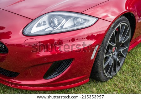 SHOREHAM-BY-SEA, WEST SUSSEX/UK - AUGUST 30 : Jaguar XK Coupe on display at Shoreham-by-Sea airfield in West Sussex on August 30, 2014 - stock photo