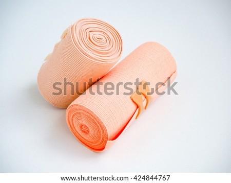 Short and long medial elastic bandage on white background - stock photo