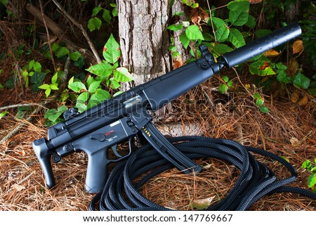 Short assault rifle that has a suppressor attached - stock photo