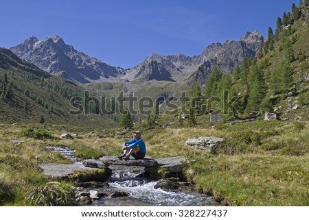 Short break at a mountain stream in the Oetztal Alps - stock photo