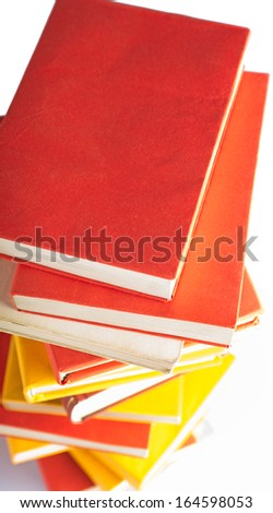 Short depth of field closeup of books stacked vertically - stock photo