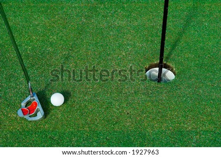 short putt on the green - stock photo
