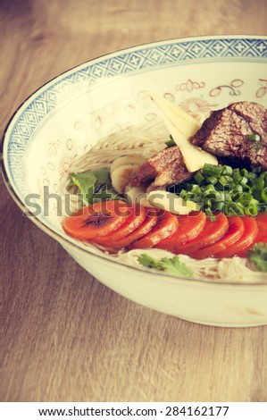 short rib beef pho, a delicous vietnamese dish. Retro vintage filter. - stock photo