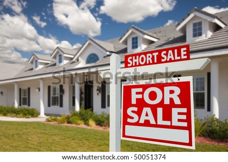 Short Sale Home For Sale Real Estate Sign in Front of New House - Right Facing. - stock photo