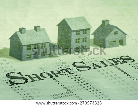 Short sales wording on past dues bills. Blurred house models background. - stock photo