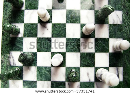 shot from above of chess pieces and board - stock photo