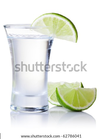 shot glass filled with clear cold alcohol - stock photo