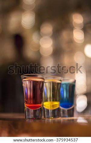 Shot Glasses in Primary Colors - stock photo
