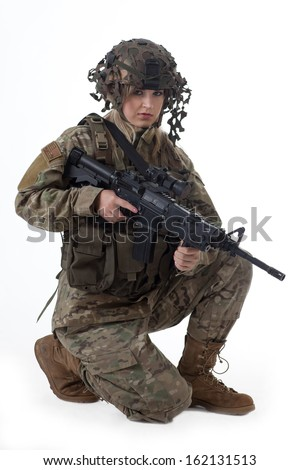 Shot of a beautiful army girl. Uniform conforms to special services(soldiers) of the NATO countries. Shot in studio. Isolated on white. - stock photo