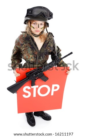 Shot of a beautiful girl holding gun. Shot in studio. Isolated on white. - stock photo