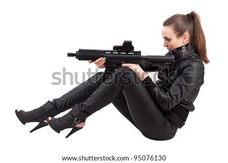 Shot of a beautiful girl posing with a gun - stock photo