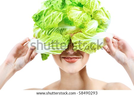 Shot of a beautiful young woman with vegetables headwear. Food concept, healthcare. - stock photo