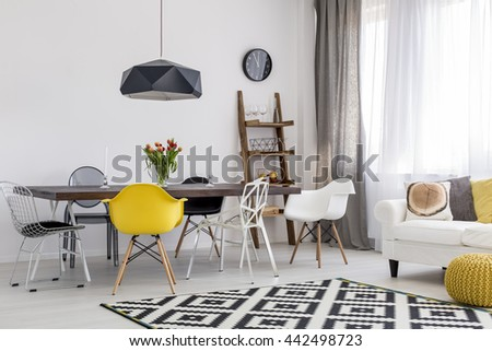 Shot of a black and white studio decorated with yellow accessories - stock photo
