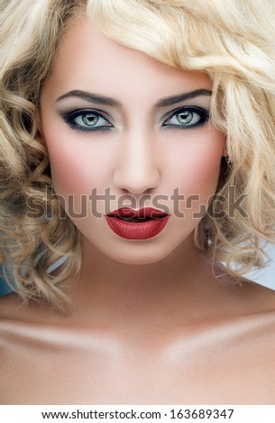 Shot of a blond woman with red lipstick - stock photo