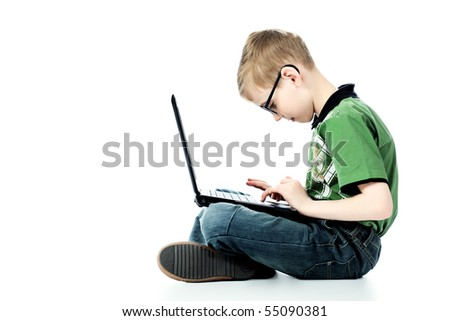 Shot of a boy sitting with his laptop. Isolated over white background. - stock photo