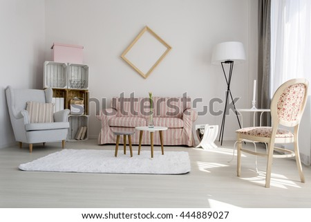 Shot of a cozy living room decorated with pastel colors - stock photo