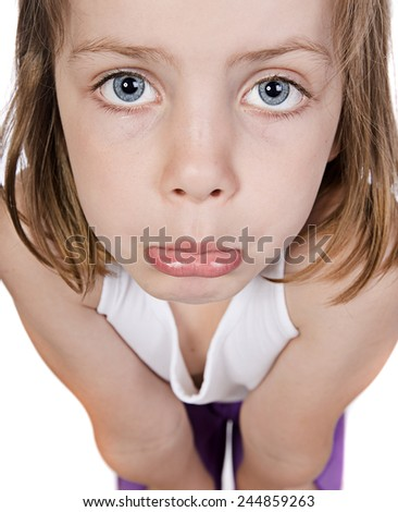 Shot of a Cute Child with Sad Face - stock photo