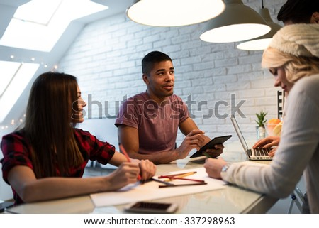 Shot of a group of young designers starting a small business. Selective focus.