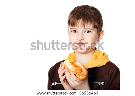 Shot of a hungry boy with a tasty hot dog. - stock photo