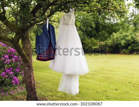 Shot of a Kilt and Wedding dress - stock photo