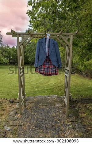 Shot of a Kilt Hanging on wooden frame - stock photo