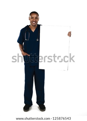 Shot of a nurse holding a blank card - stock photo