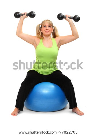 Shot of a overweight young woman exercise on a fitness ball against white background. - stock photo