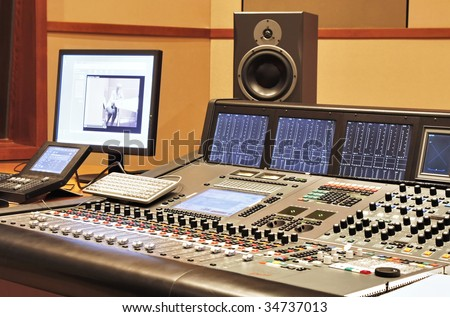 Shot of a recording studio, complete with technition and equipment. - stock photo