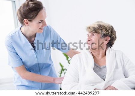 Shot of a senior patient smiling to her nurse - stock photo