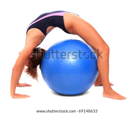 Shot of a sporty young woman with blue ball. - stock photo