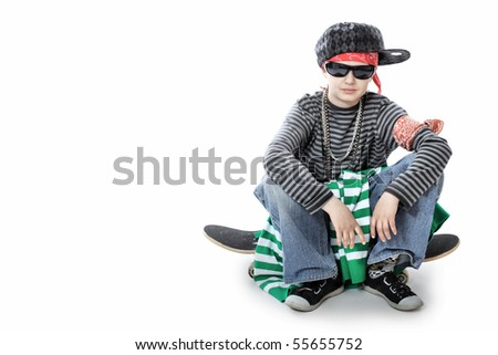 Shot of a trendy teenager posing with skateboard. Isolated over white background. - stock photo