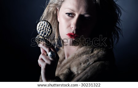 Shot of a Vintage Styled Female in Fur Coat Checking her Makeup - stock photo