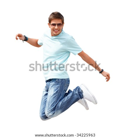 Shot of a young smiling man, that is jumping. He is happy. He is smiling. Isolated on white. - stock photo