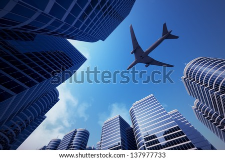 Shot of airplane flying above glass office buildings. Fisheye lens effect. - stock photo