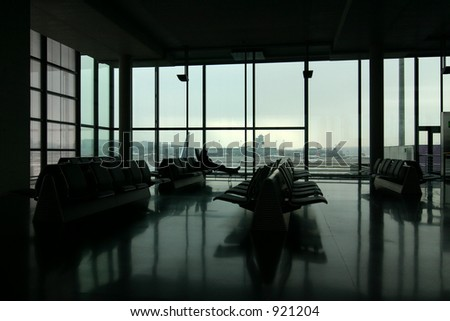 shot of an airport terminal. Quadtoned to bring out lighting. Taken in Zurich, Switzerland. - stock photo