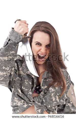 Shot of angry girl holding a knife - stock photo