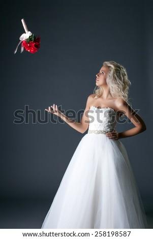 Shot of elegant bride throws her bouquet  - stock photo