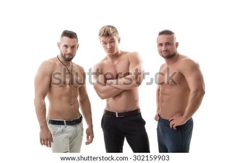 Shot of flirting male models posing at camera - stock photo