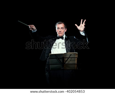 Shot of music director conducting with inspiration - stock photo