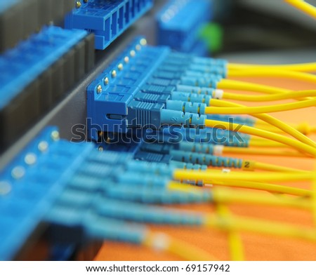 shot of network cables and servers in a technology data center - stock photo