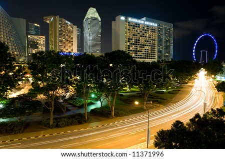Shot of Singapore's new Flyer and hotels at night - stock photo