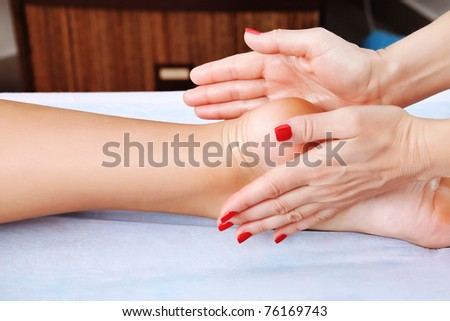 Shot of spa salon, reflexology foot massage. - stock photo