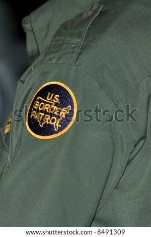 Shot of the arm badge of a Border Patrol Agent. - stock photo