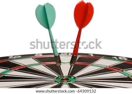 Shot of two darts on bull's eye of a dart board  isolated on  white background - stock photo