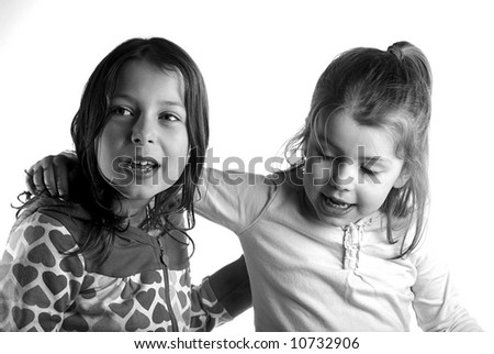 Shot of two young sisters looking off camera - stock photo